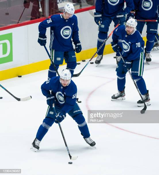 Bo Horvat of the Vancouver Canucks along with Antoine Roussel and Tanner Pearson get ready to start a drill on the first day of the Vancouver Canucks...