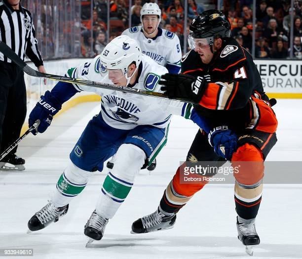 Bo Horvat of the Vancouver Canucks battles for position against Cam Fowler of the Anaheim Ducks during the game on March 14 2018 at Honda Center in...