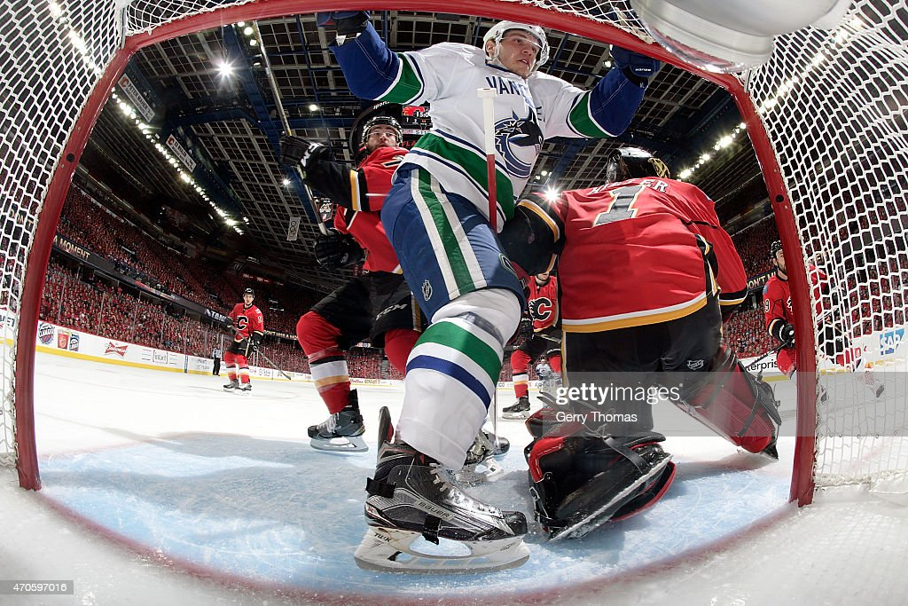 Bo Horvat #53 of the Vancouver Canucks bumps into Jonas Hiller #1 of the Calgary Flames at Scotiabank Saddledome for Game Four of the Western Quarterfinals during the 2015 NHL Stanley Cup Playoffs on April 21, 2015 in Calgary, Alberta, Canada.
