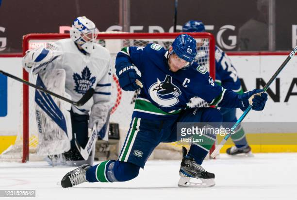 Bo Horvat of the Vancouver Canucks celebrates after scoring a goal of goalie Michael Hutchinson of the Toronto Maple Leafs during NHL hockey action...