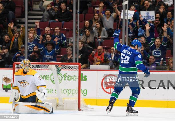 Bo Horvat of the Vancouver Canucks celebrates after scoring a goal on Juuse Saros of the Nashville Predators during their NHL game at Rogers Arena on...