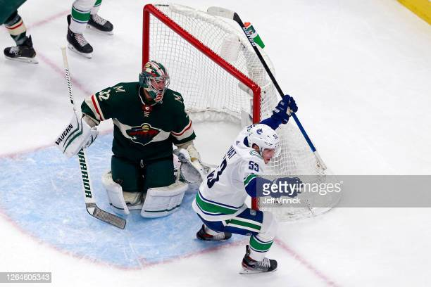 Bo Horvat of the Vancouver Canucks celebrates after scoring a goal past Alex Stalock of the Minnesota Wild during the third period in Game Four of...