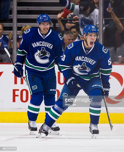 Bo Horvat of the Vancouver Canucks celebrates after scoring a goal against the Calgary Flames as Sven Baertschi looks on in NHL action on October...