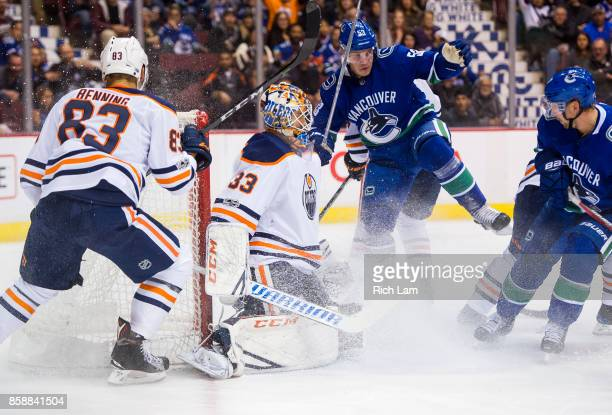 Bo Horvat of the Vancouver Canucks celebrates after scoring a goal against goalie Cam Talbot of the Edmonton Oilers while Matthew Benning of the...