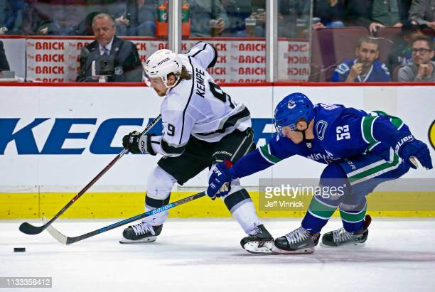 Bo Horvat of the Vancouver Canucks checks Adrian Kempe of the Los Angeles Kings during their NHL game at Rogers Arena March 28 2019 in Vancouver...