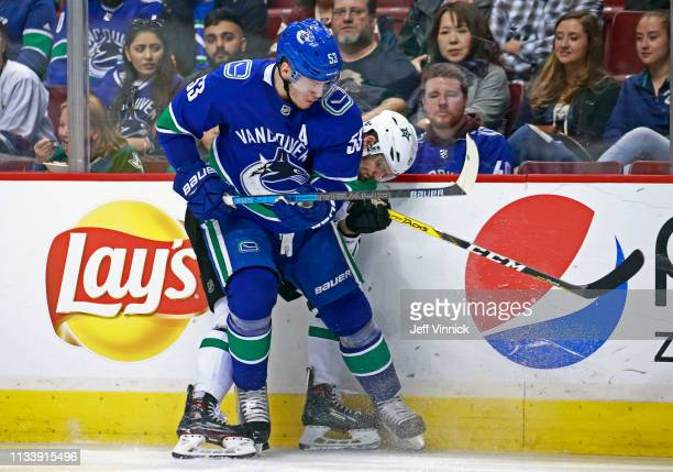 Bo Horvat of the Vancouver Canucks checks Alexander Radulov of the Dallas Stars during their NHL game at Rogers Arena March 30 2019 in Vancouver...
