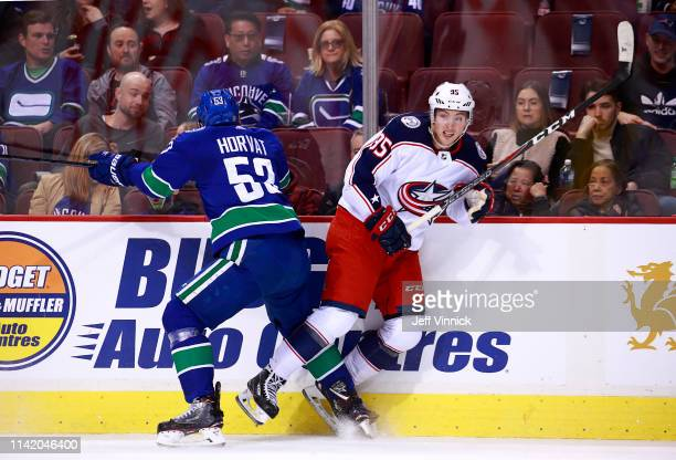 Bo Horvat of the Vancouver Canucks checks Matt Duchene of the Columbus Blue Jackets during their NHL game at Rogers Arena March 24 2019 in Vancouver...