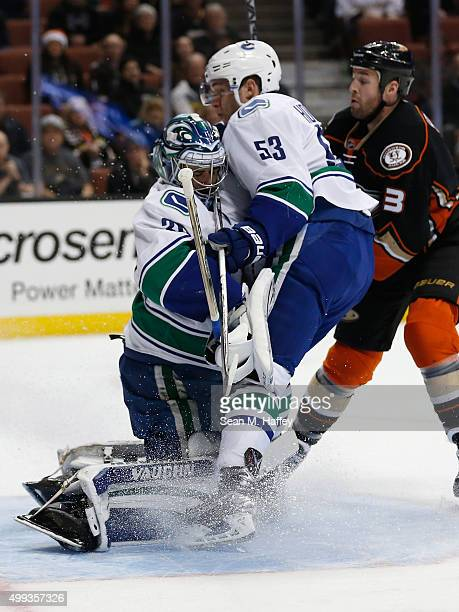 Bo Horvat of the Vancouver Canucks collides with teammate Ryan Miller as Clayton Stoner of the Anaheim Ducks follows the play during a game at Honda...