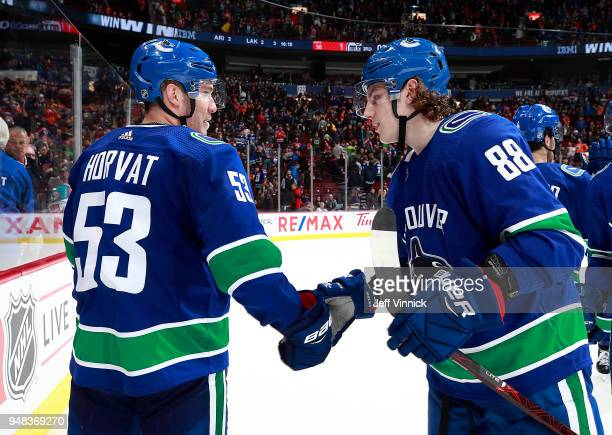 Bo Horvat of the Vancouver Canucks congratulates teammate Adam Gaudette during their NHL game against the Edmonton Oilers at Rogers Arena March 29...