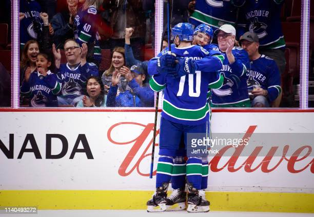 Bo Horvat of the Vancouver Canucks is congratulated by teammate Tanner Pearson after scoring during their NHL game against the San Jose Sharks at...