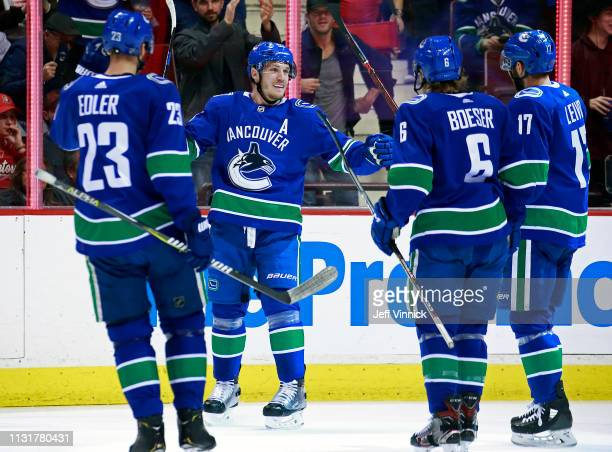 Bo Horvat of the Vancouver Canucks is congratulated by teammates after scoring during their NHL game against the Ottawa Senators at Rogers Arena...