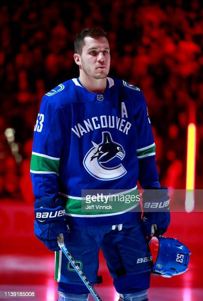 Bo Horvat of the Vancouver Canucks listens to the national anthem during their NHL game against the Los Angeles Kings at Rogers Arena March 28 2019...