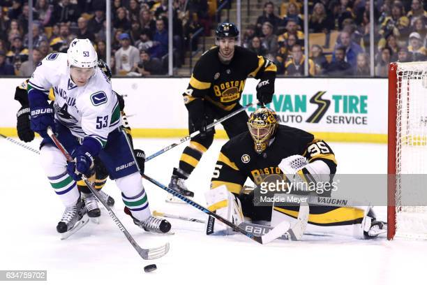 Bo Horvat of the Vancouver Canucks looks for a shot against Anton Khudobin of the Boston Bruins during the second period at TD Garden on February 11...