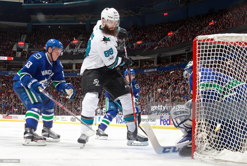 Bo Horvat #53 of the Vancouver Canucks looks on as Ryan Miller #30 of the Vancouver Canucks makes save off the shot of Brent Burns #88 of the San Jose Sharks during their NHL game at Rogers Arena February 2, 2017 in Vancouver, British Columbia, Canada. San Jose won 4-1.