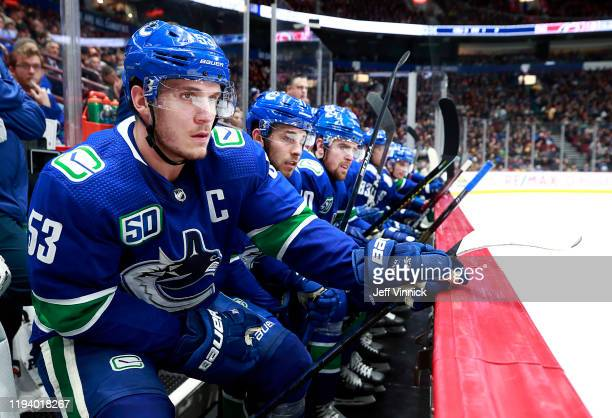 Bo Horvat of the Vancouver Canucks looks on from the bench during their NHL game against the Carolina Hurricanes at Rogers Arena December 12, 2019 in...