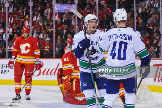 Bo Horvat of the Vancouver Canucks scores a goal on Mike Smith of the Calgary Flames during an NHL game at Scotiabank Saddledome on October 6 2018 in...