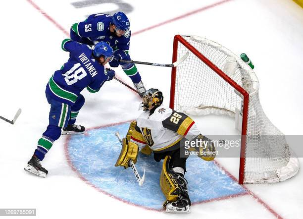 Bo Horvat of the Vancouver Canucks scores a goal past Marc-Andre Fleury of the Vegas Golden Knights during the second period in Game Four of the...