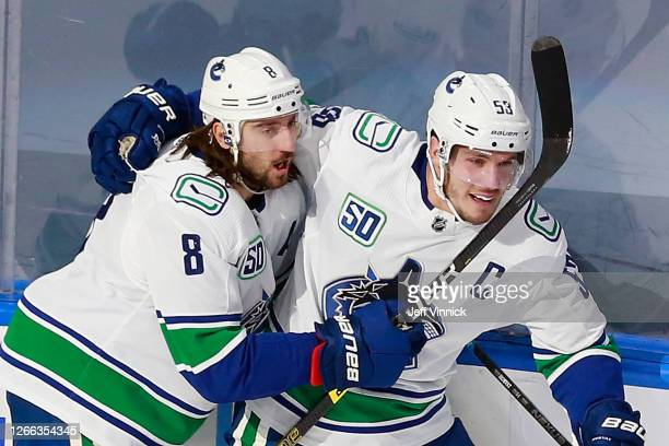 Bo Horvat of the Vancouver Canucks scores a shorthanded goal at 7:23 of the first period against the St. Louis Blues and is joined by Christopher...