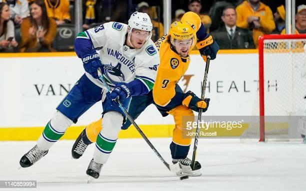 Bo Horvat of the Vancouver Canucks skates against Filip Forsberg of the Nashville Predators at Bridgestone Arena on April 4 2019 in Nashville...