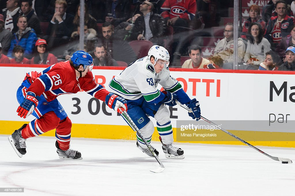 Bo Horvat #53 of the Vancouver Canucks skates the puck away from Jeff Petry #26 of the Montreal Canadiens during the NHL game at the Bell Centre on November 16, 2015 in Montreal, Quebec, Canada. The Montreal Canadiens defeated the Vancouver Canucks 4-3 in overtime.