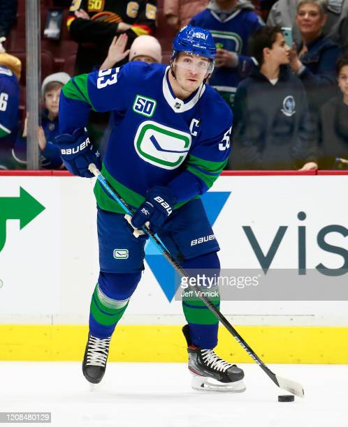 Bo Horvat of the Vancouver Canucks skates up ice during their NHL game against the Boston Bruins at Rogers Arena February 22, 2020 in Vancouver,...