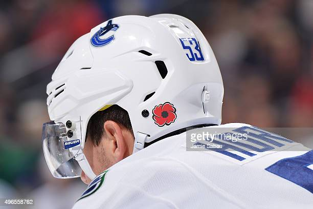 Bo Horvat of the Vancouver Canucks sports a Poppy decal on his helmet to commemorate Remembrance Day in Canada during a game against the Columbus...