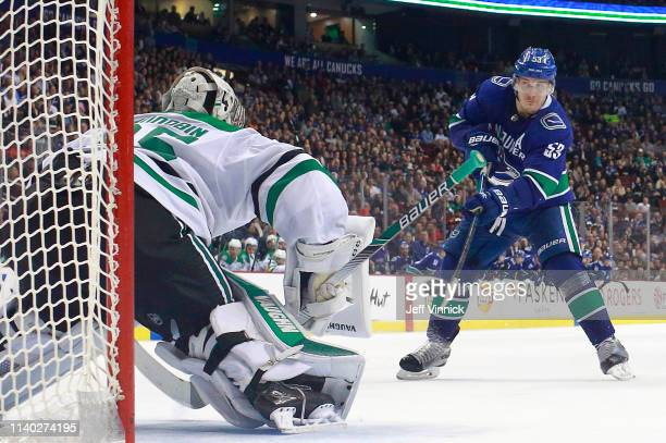 Bo Horvat of the Vancouver Canucks takes a shot on Anton Khudobin of the Dallas Stars in the shootout during their NHL game at Rogers Arena March 30...