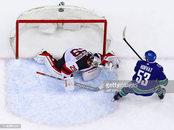 Bo Horvat of the Vancouver Canucks takes a shot on Mackenzie Blackwood of the New Jersey Devils during their NHL game at Rogers Arena March 15 2019...