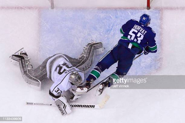 Bo Horvat of the Vancouver Canucks trips over Jonathan Quick of the Los Angeles Kings during their NHL game at Rogers Arena March 28 2019 in...
