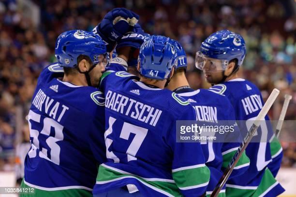 Bo Horvat Sven Baertschi and Ben Hutton congratulate Vancouver Canucks right wing Nikolay Goldobin after scoring a goal during their NHL preseason...