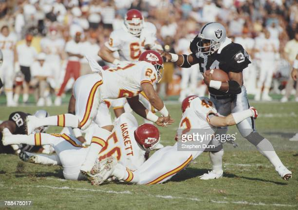 Bo Jackson Full Back for the Los Angeles Raiders is tackled by Jeff Donaldson Kevin Porter and Dino Hackett for the Kansas City Chiefs during their...