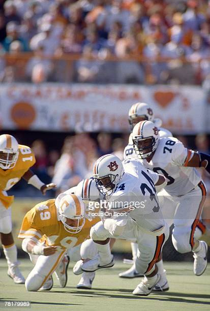 Bo Jackson of the Auburn Tigers carries the ball against the Tennessee Volunteers in a circa mid 1980s NCAA college football game at Neyland Stadium...
