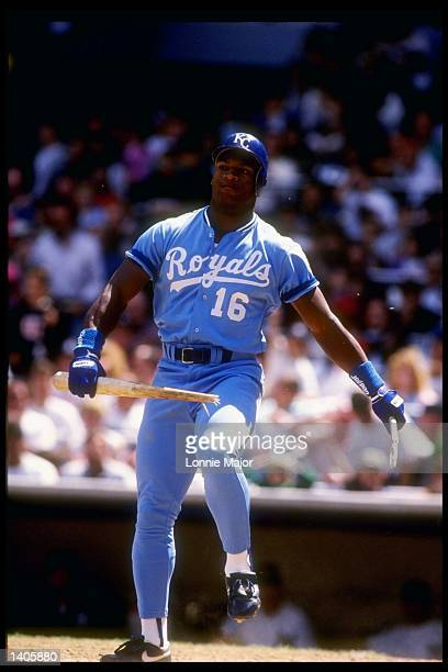 Bo Jackson of the Kansas City Royals breaks his batter over his leg during an MLB game against the New York Yankees circa 1988 at Yankee Stadium in...