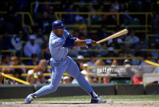 Bo Jackson of the Kansas City Royals watches the flight of the ball as he follows through on his swing during a game in the 1990 season.