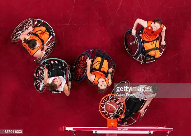 Bo Kramer of Team Netherlands and Agurtzane Egiluz Ibarguen of Team Spain watch a shot during the women's Preliminary Round Group B wheelchair...