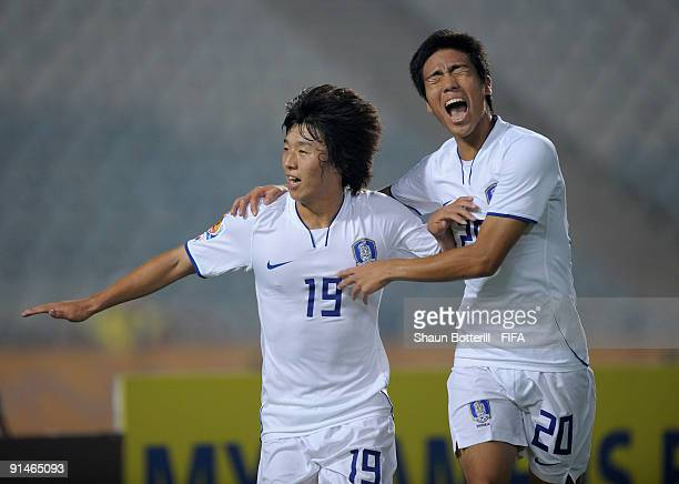 Bo Kyung Kim of Korea Republic is congratulated by team-mate Hee Seong Park after scoring the opening goal of the FIFA U20 World Cup Round of 16...