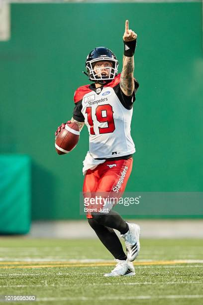 Bo Levi Mitchell of the Calgary Stampeders directs a receiver downfield in the game between the Calgary Stampeders and Saskatchewan Roughriders at...