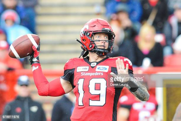 Bo Levi Mitchell of the Calgary Stampeders makes a pass against the Hamilton TigerCats during a CFL game at McMahon Stadium on June 16 2018 in...