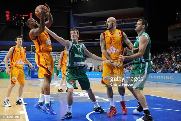 Bo McCalebb of Macedonia Goran Dragic of Slovenia Pero Antic of Macedonia and Goran Jagodnik of Slovenia fight for the ball during the EuroBasket...