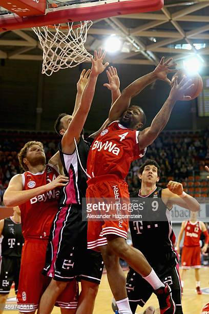 Bo McCalebb of Muenchen is challenged by Andrej Mangold of Bonn during the Beko Basketball Bundesliga match between FC Bayern Muenchen and Telekom...