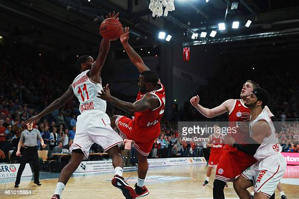 Bo McCalebb of Muenchen is challenged by Bradley Wanamaker of Brose Baskets during the Beko BBL basketball match between Brose Baskets and FC Bayern...
