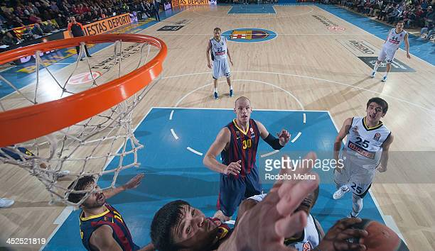 Bo McCalebbÊ#4 of Fenerbahce Ulker Istanbul competes with Kostas Papanikolau #16 of FC Barcelona during the 20132014 Turkish Airlines Euroleague...