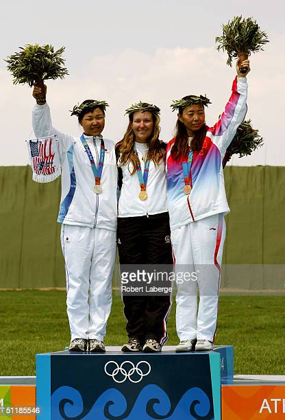 Bo Na Lee of Korea Kimberley Rhode of the USA and E Gao of China pose on the podium after earning respectively Silver Gold and Bronze medals at the...