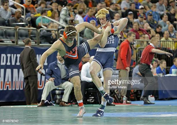 Bo Nickal of the Penn State Nittany Lions wrestles Chandler Rogers of the Oklahoma State Cowboys during session three of the NCAA Wrestling...