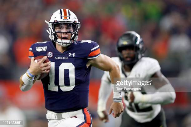 Bo Nix of the Auburn Tigers carries the ball against the Oregon Ducks in the second quarter during the Advocare Classic at ATT Stadium on August 31...