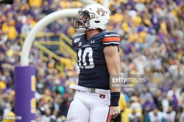 Bo Nix of the Auburn Tigers celebrates after a touchdown against the LSU Tigers during the first half at Tiger Stadium on October 26, 2019 in Baton...