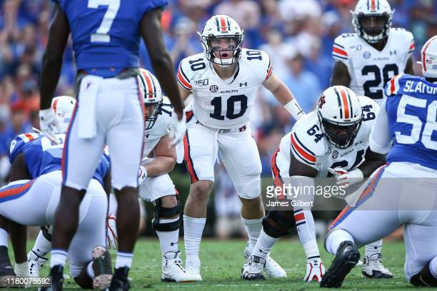 Bo Nix of the Auburn Tigers directs his team during the first quarter of a game against the Florida Gators at Ben Hill Griffin Stadium on October 05...
