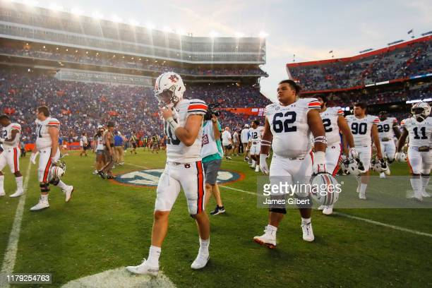 Bo Nix of the Auburn Tigers exits the field after a game against the Florida Gators at Ben Hill Griffin Stadium on October 05 2019 in Gainesville...