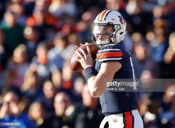 Bo Nix of the Auburn Tigers looks to pass against the Georgia Bulldogs in the first half at JordanHare Stadium on November 16 2019 in Auburn Alabama