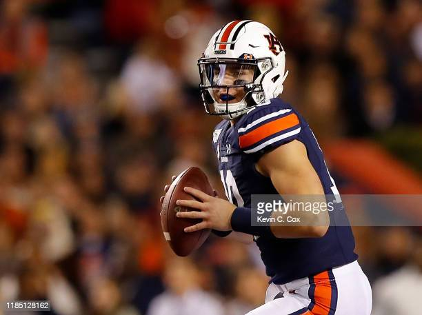 Bo Nix of the Auburn Tigers looks to pass against the Mississippi Rebels in the first half at JordanHare Stadium on November 02 2019 in Auburn Alabama